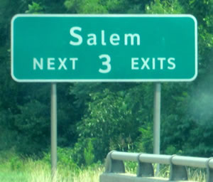 "An image of a guide sign is shown with the legend ""Salem NEXT 3 EXITS."" The lower-case letters of the word Salem are much smaller than the accepted height for the corresponding initial upper-case letter."