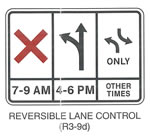 "Regulatory Sign ""REVERSIBLE LANE CONTROL (R3-9d)"" is shown as a horizontal rectangular white sign with a black border. The sign is shown divided horizontally into thirds by two vertical black lines that extend from the upper to lower border. The sign is also divided vertically into two sections by a horizontal black line one-fourth of the way from the bottom border. On the left third of the sign, a large red ""X"" is shown above the horizontal black line, and the legend ""7-9 AM"" in black is shown below the line. On the middle third of the sign, a vertical black arrow is shown above the line with two arrowheads: one pointing upward and one on the left curving up and to the left. The legend ""4-6 PM"" in black is shown below the line. On the right third of the sign, two opposing curving arrows are shown above the line, one pointing upward and to the left, and one pointing downward and to the right. The bases of the shafts of the two arrows are directly in line with each other in the vertical axis. The word ""ONLY"" in black is shown centered below the arrows. The words ""OTHER TIMES"" in black are shown on two lines below the horizontal line."