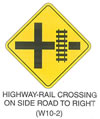 "Railroad and Light Rail Transit Grade Crossing Sign ""HIGHWAY-RAIL CROSSING ON SIDE ROAD TO RIGHT (W10-2)"" is shown as a diamond-shaped yellow sign with a black border and legend. The sign shows a cross intersection with an elongated right arm. A symbol of a vertical railroad track is shown across the right arm."