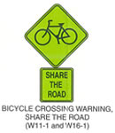 "Pedestrian and Bicycle Sign ""BICYCLE CROSSING WARNING, SHARE THE ROAD (W11-1)"" is shown as a diamond-shaped green sign with a black border. It shows a black symbol of a bicycle, W16-1 sign shown directly below it. W16-1 is shown as a vertical rectangular yellow sign with a black border. It shows the words ""SHARE THE ROAD"" in black on three lines."
