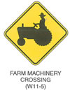 "Warning Sign ""FARM MACHINERY CROSSING (W11-5a)"" is shown as a diamond-shaped sign with an oblique symbol of a tractor."