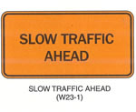 "Temporary Traffic Control Signs ""SLOW TRAFFIC AHEAD (W23-10"" is shown as a horizontal rectangular sign. It shows the words ""SLOW TRAFFIC AHEAD"" on two lines."