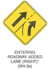 "Warning Sign ""ENTERING ROADWAY ADDED LANE (RIGHT) (W4-3a)"" is shown as a diamond-shaped sign. It shows a diagonal arrow pointing up and to the right. This arrow is to the left of a dividing line that changes from solid to dotted and a curved arrow to the right of the dotted line. This sign was anticipated for inclusion in the 2003 edition of the MUTCD at the time of this printing."